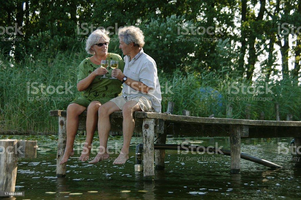Elderly Couple on little Pier stock photo