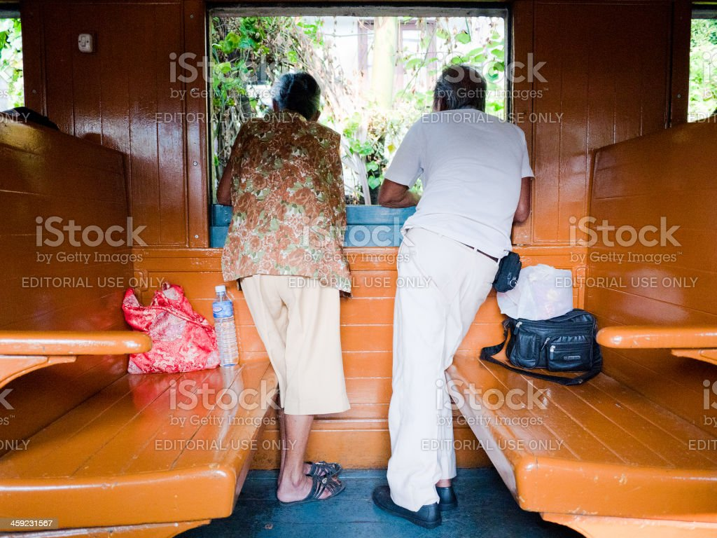 Elderly Couple on Train looking out of Window royalty-free stock photo