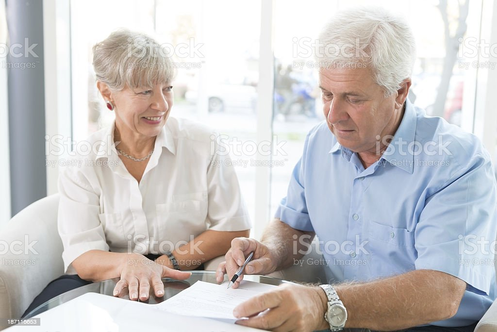 Elderly couple purchasing life insurance royalty-free stock photo