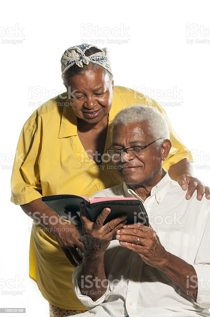 Elderly couple reading book and smiling. Grey-haired man. royalty-free stock photo