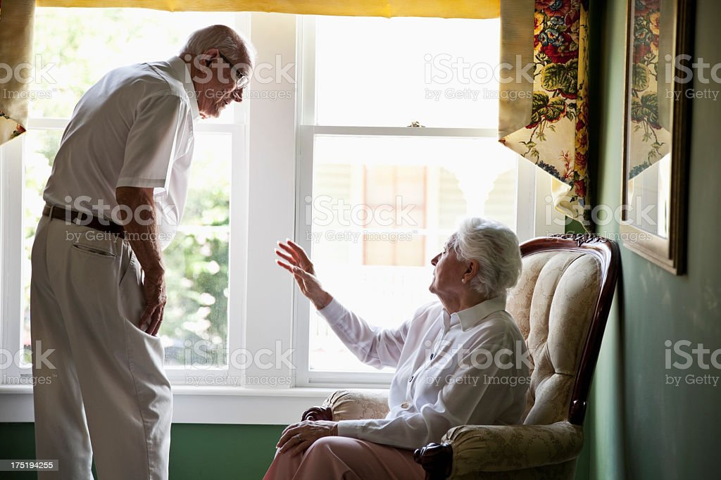 Elderly couple talking at home stock photo