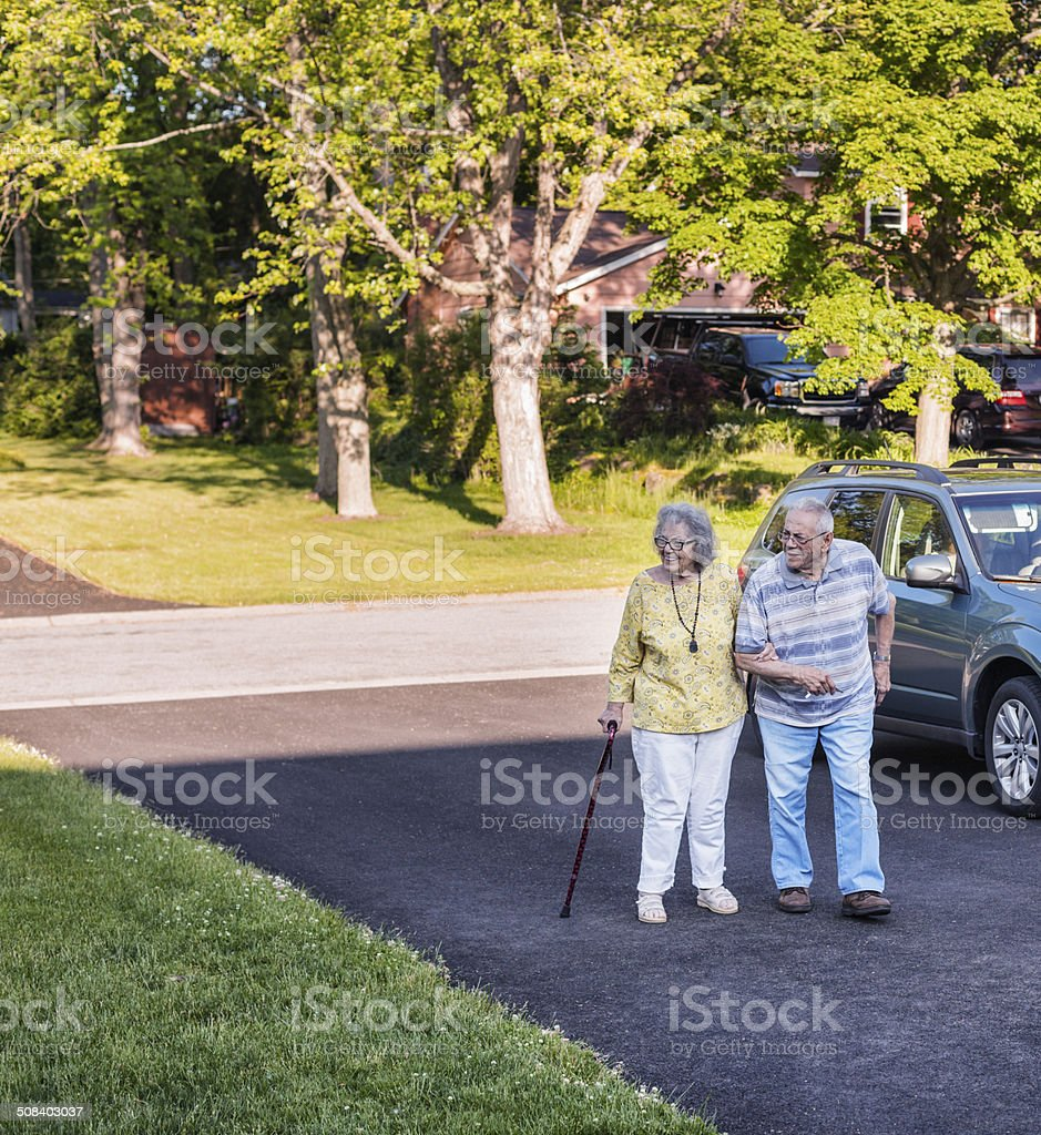 Elderly Couple Walking On Driveway royalty-free stock photo