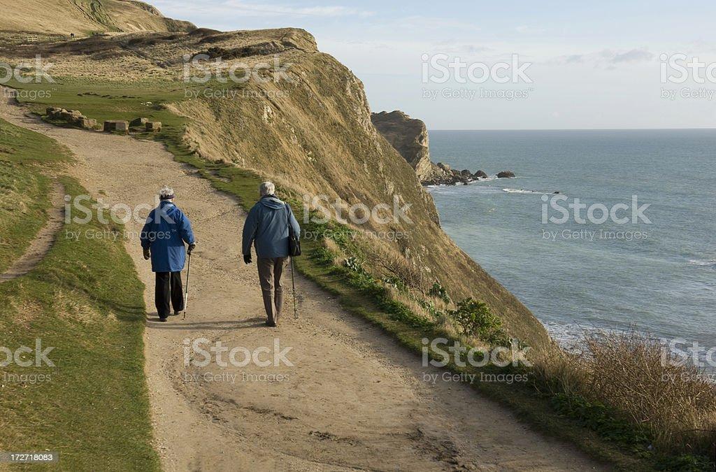 Elderly couple walking on the Dorset Coastal Path , England, UK stock photo