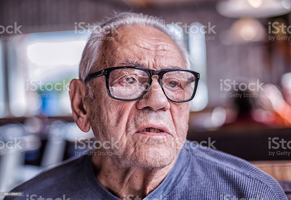 Elderly Dementia Man Asking Question While Waiting For Breakfast stock photo