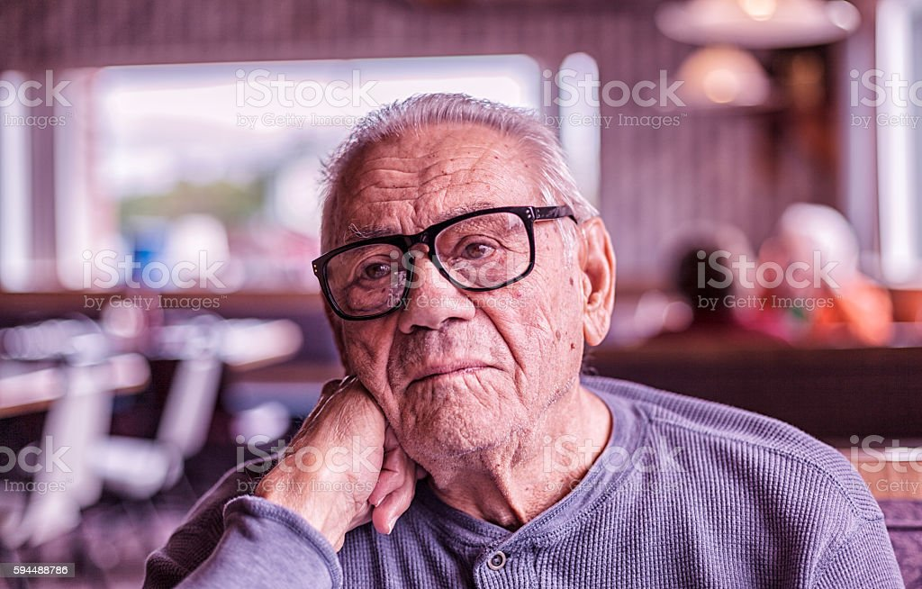 Elderly Dementia Man Day Dreaming Waiting For Breakfast stock photo