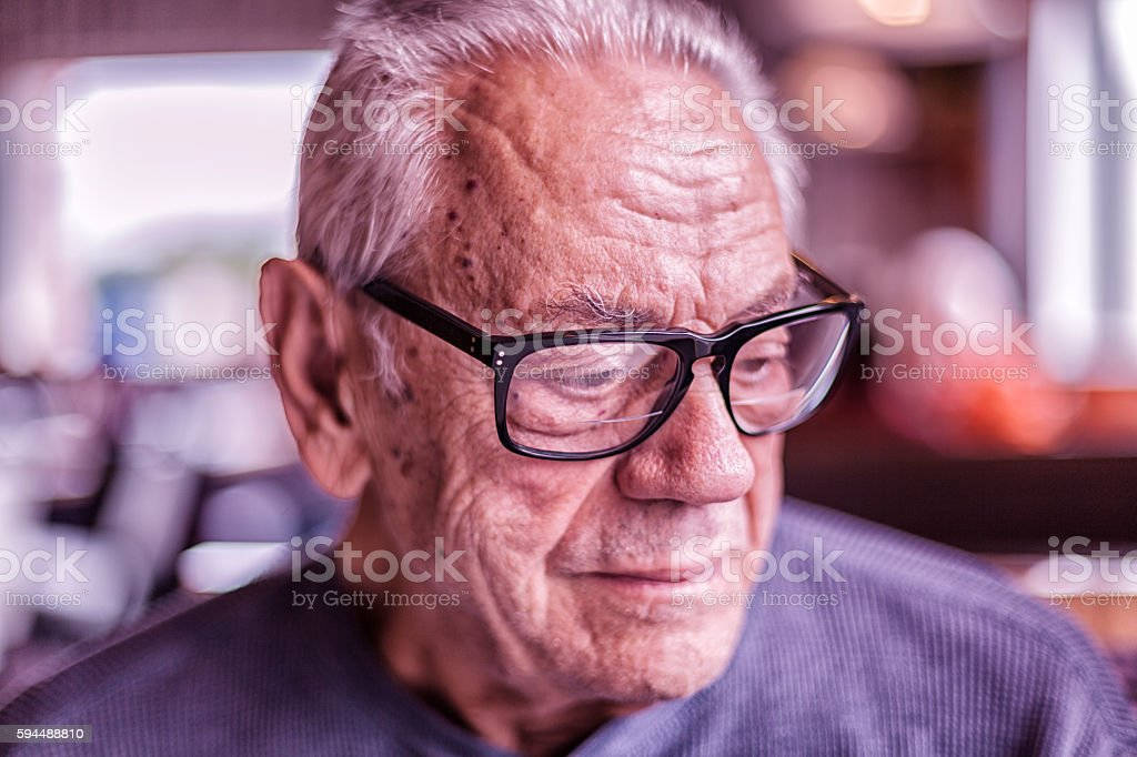Elderly Dementia Man Waiting For Breakfast Looking Down stock photo