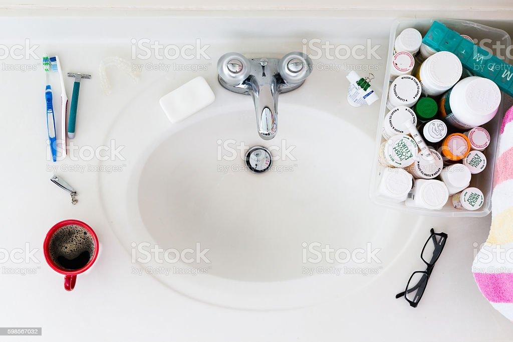 Elderly Domestic Bathroom Sink with Medicines stock photo