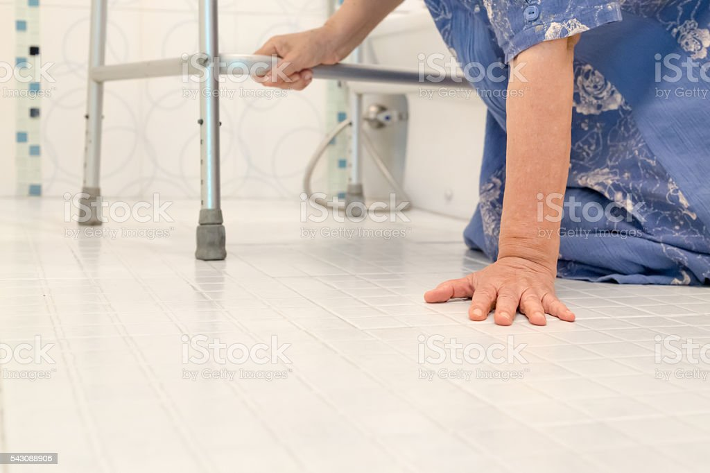 elderly falling in bathroom stock photo