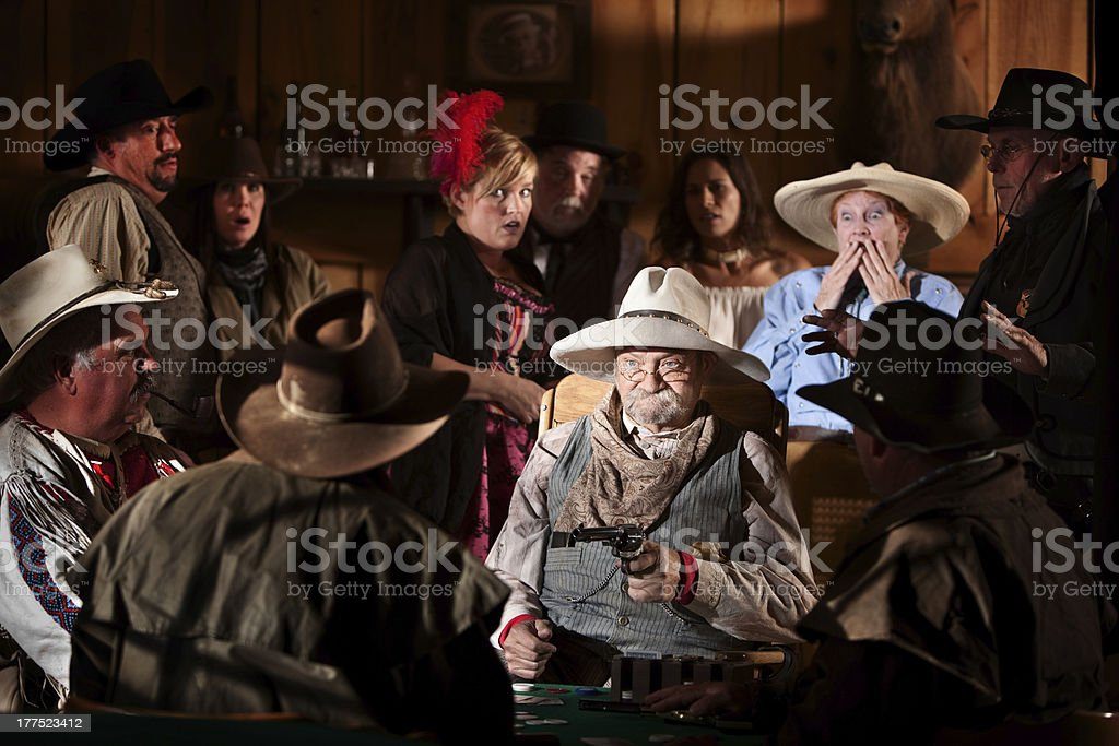 Elderly Gambler Points Gun stock photo