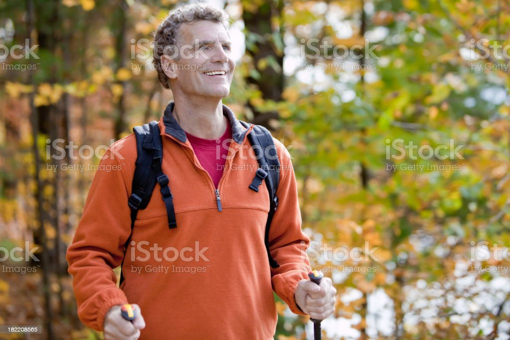 Elderly gentleman hiking in the forest royalty-free stock photo