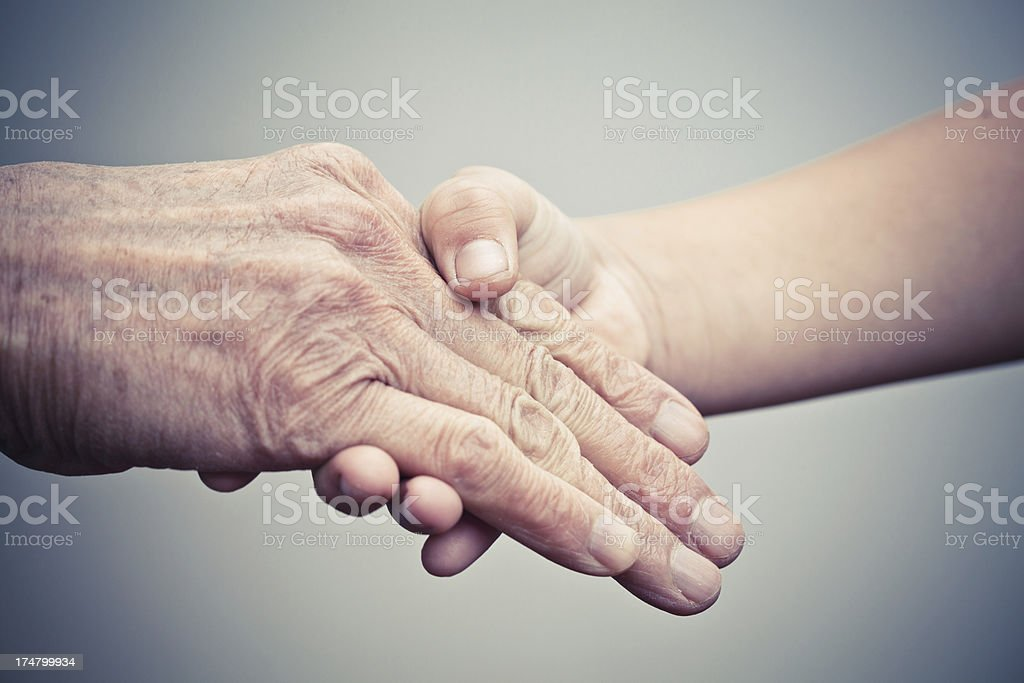 Elderly hand and caregiver royalty-free stock photo