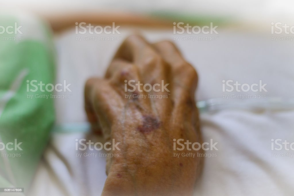 Elderly Hand Holding Oxygen Tubing stock photo