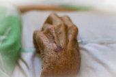 Elderly Hand Holding Oxygen Tubing