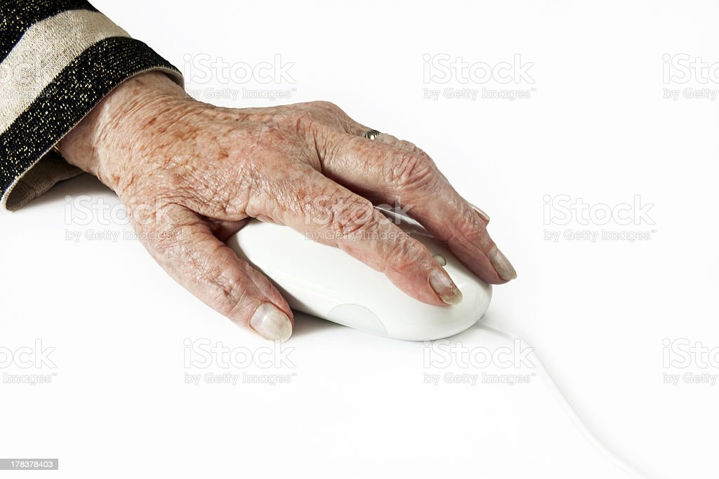 Elderly Hand on Computer Mouse royalty-free stock photo