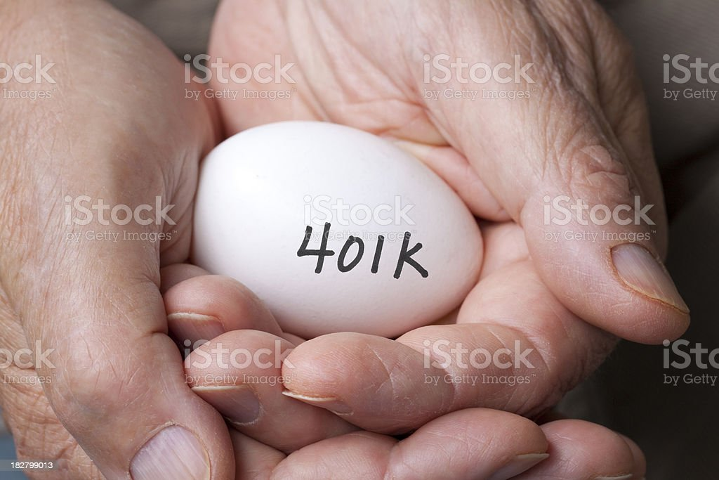 Elderly hands with egg and 401k royalty-free stock photo