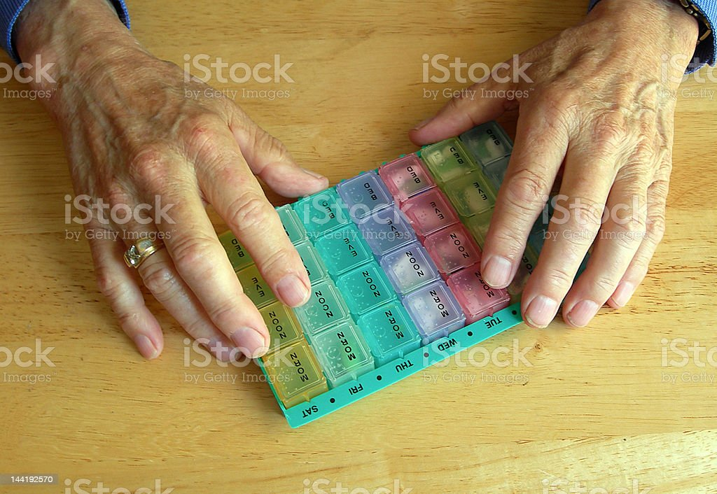 Elderly hands with pillbox royalty-free stock photo