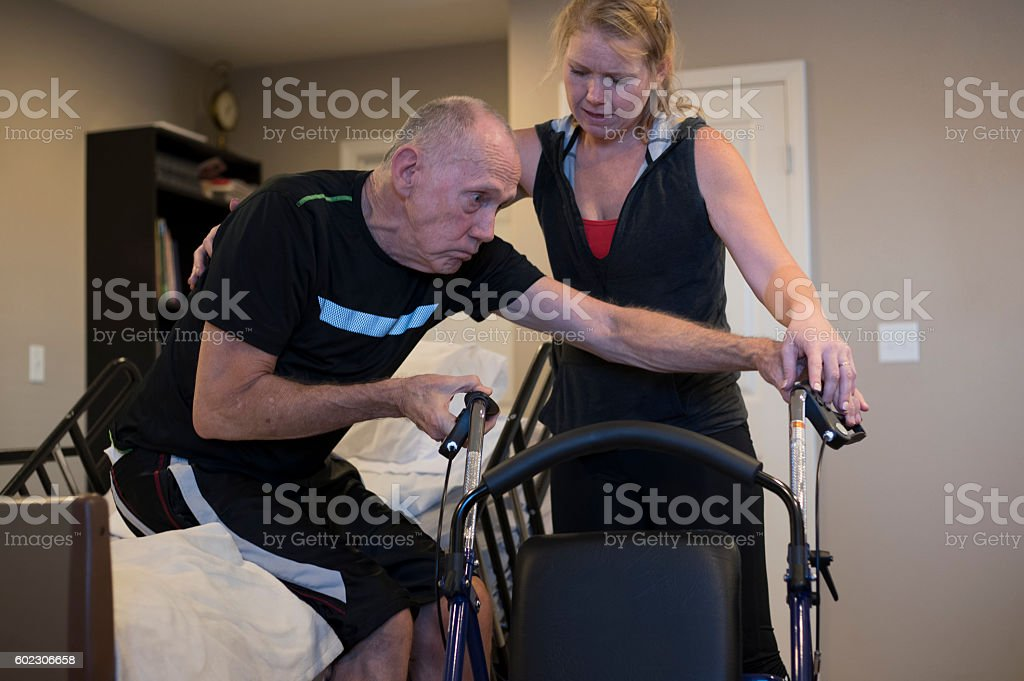Elderly Hospice Patient with Daughter stock photo