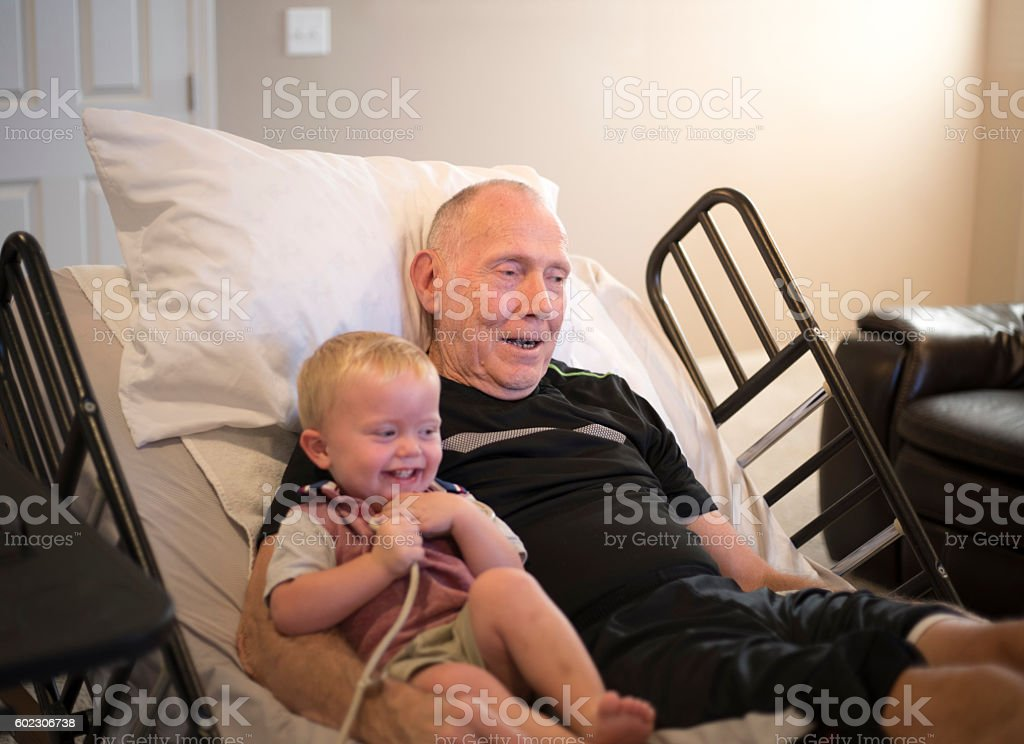 Elderly Hospice Patient with Grandson stock photo