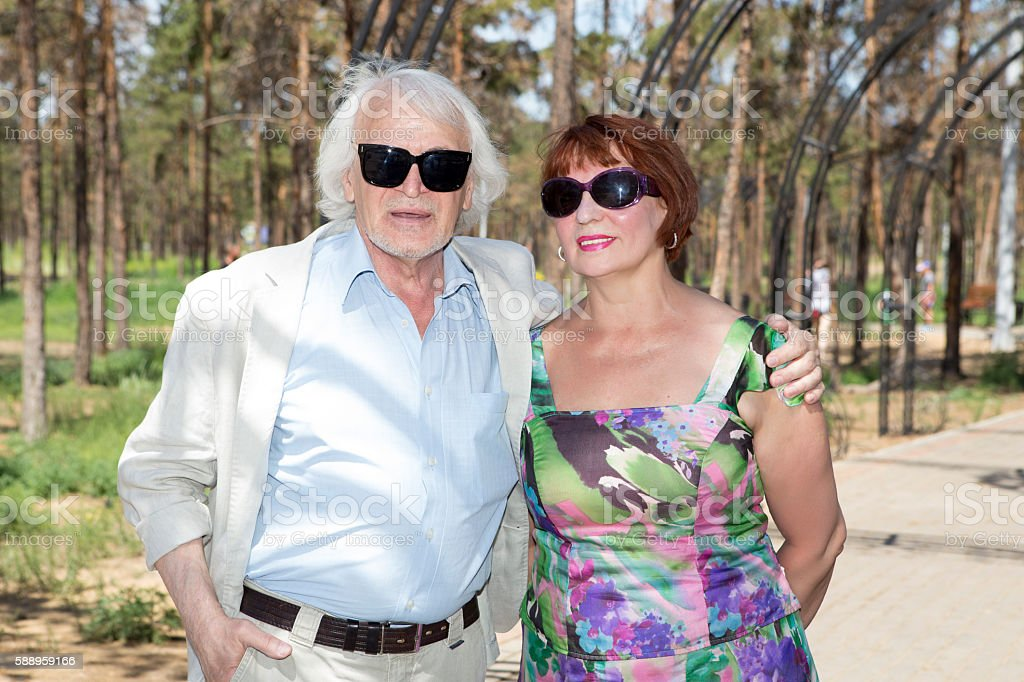 Elderly husband and wife for a walk stock photo