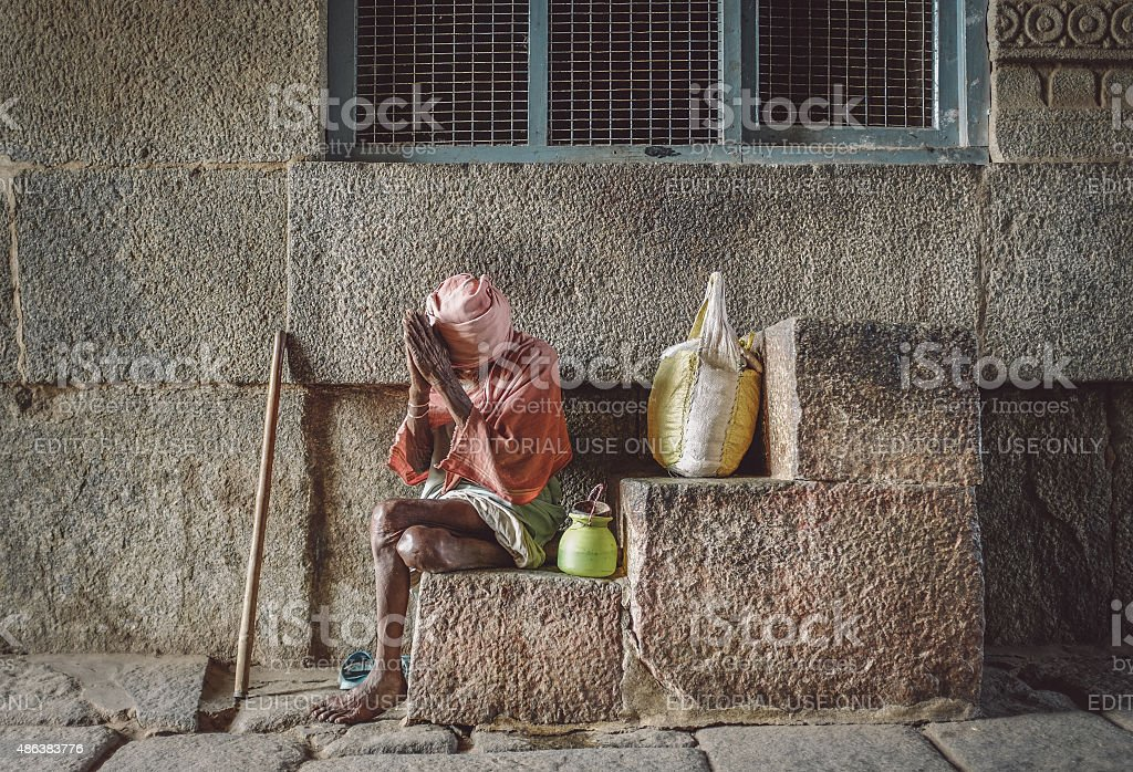Elderly Indian beggar stock photo