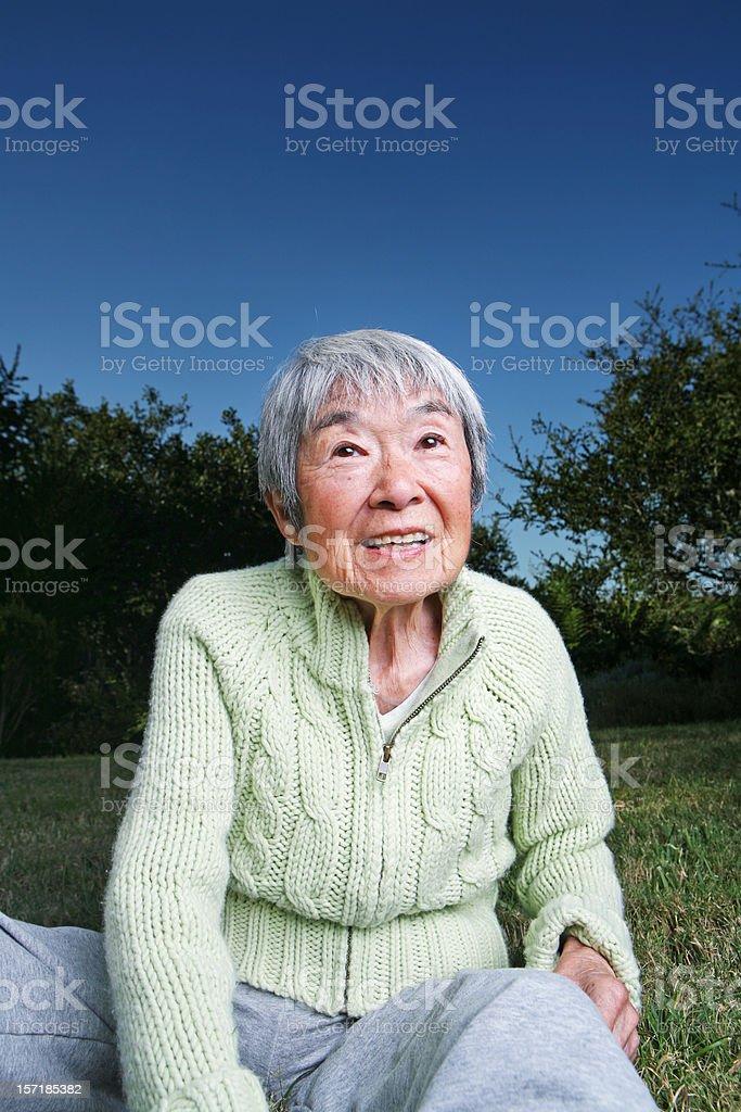 Elderly Japanese Grandma Enjoying the Outdoors royalty-free stock photo