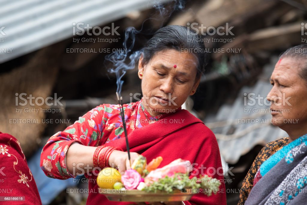 Elderly ladies watching a passing ceremony procession. stock photo