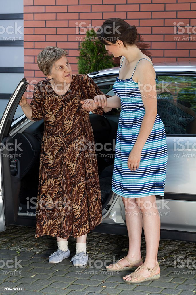 Elderly lady after driving stock photo
