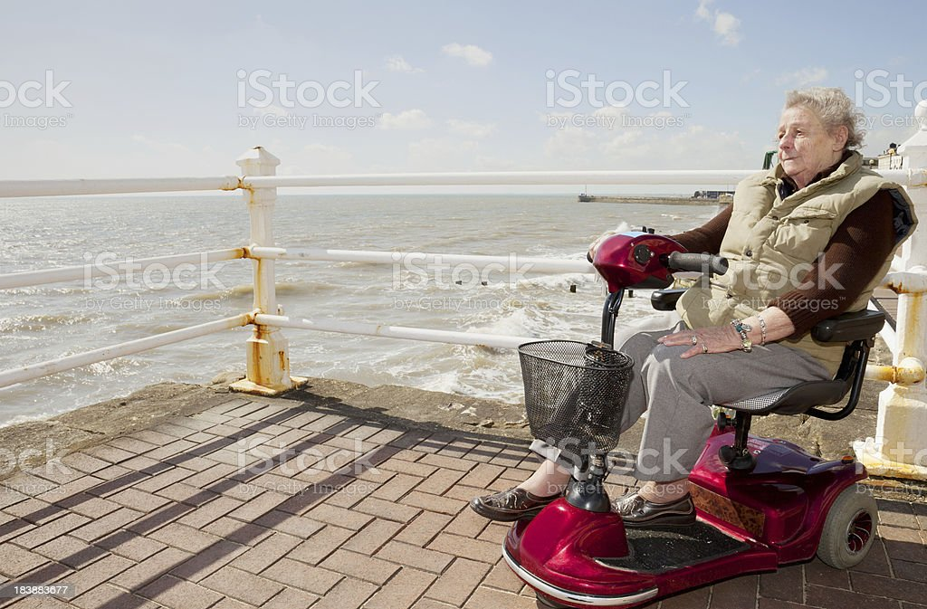 Elderly Lady by the Sea stock photo
