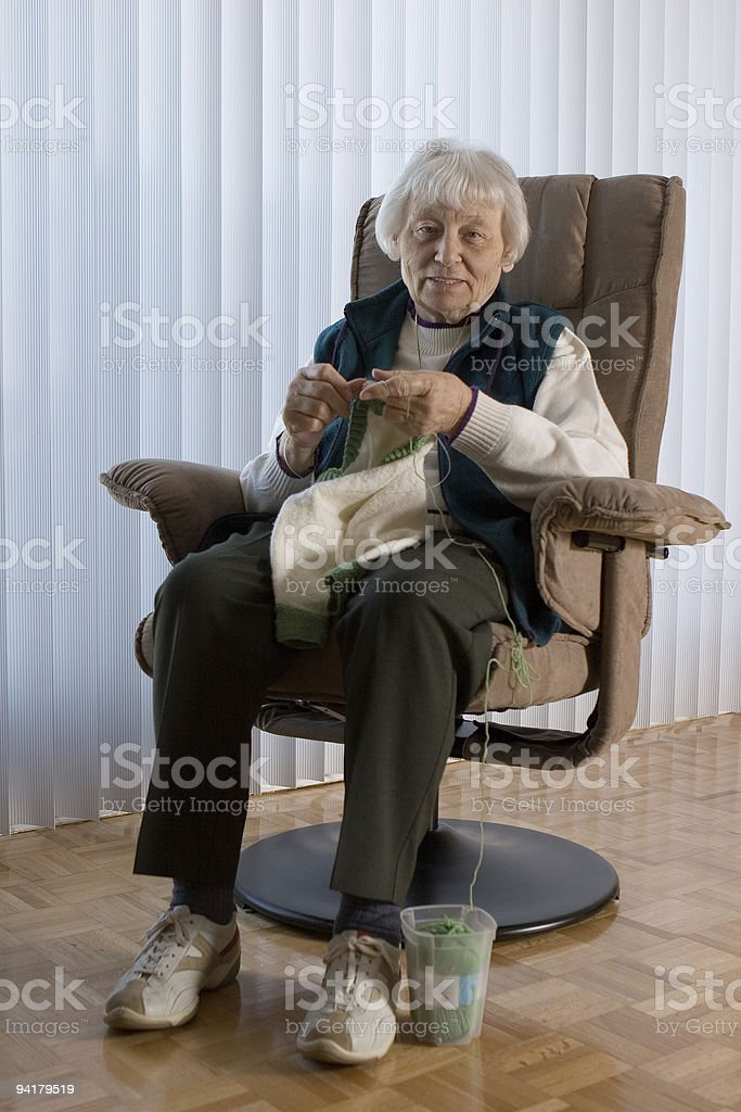 Elderly lady knitting royalty-free stock photo