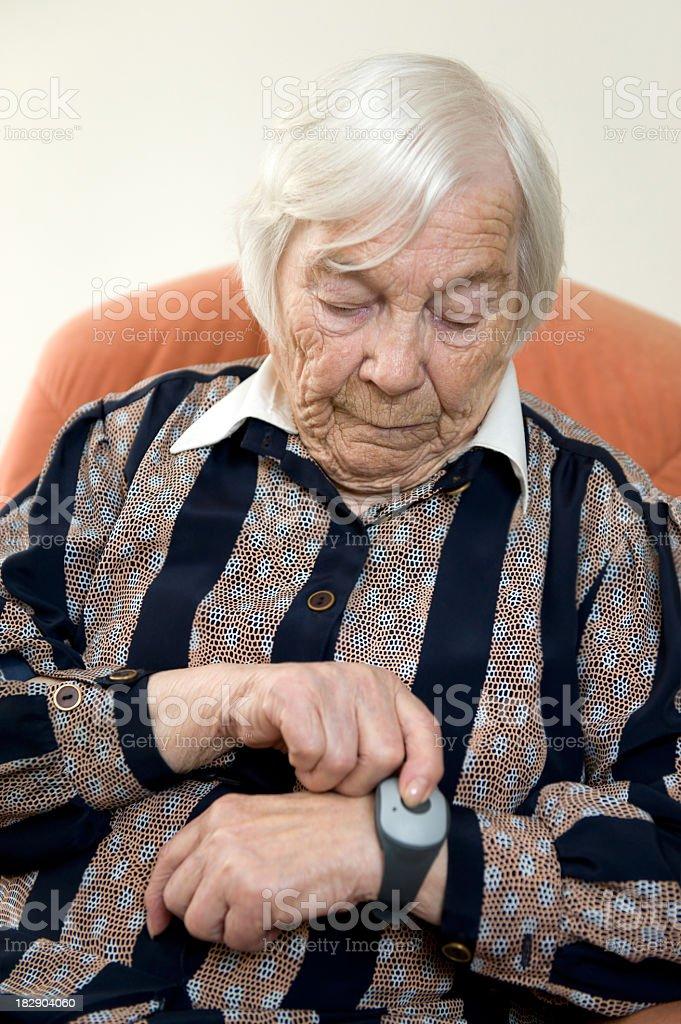 Elderly lady using emergency call system stock photo