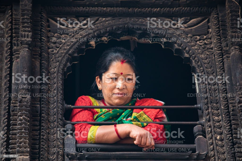 Elderly lady watching a passing ceremony procession. stock photo
