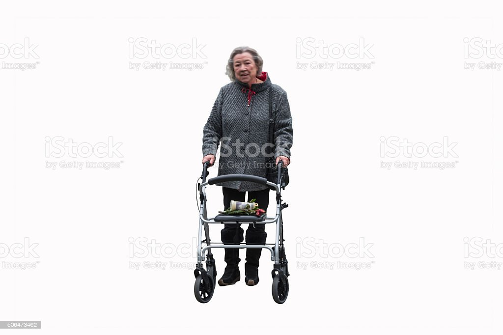 Elderly lady with a walker stock photo