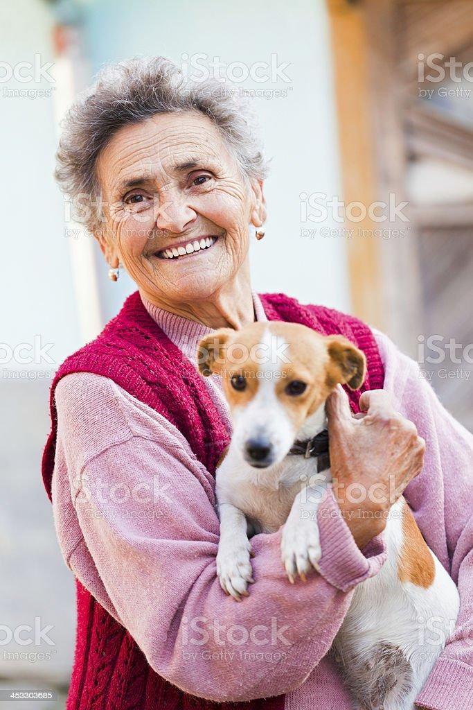Elderly Lady with Pet stock photo