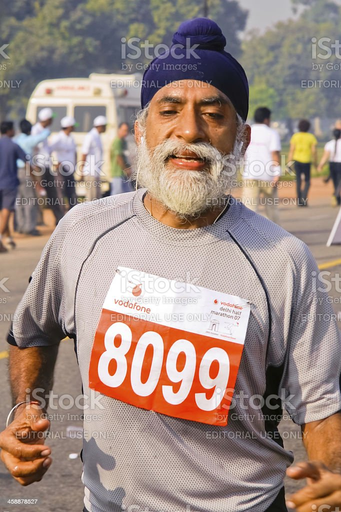 Elderly male marathon runner royalty-free stock photo