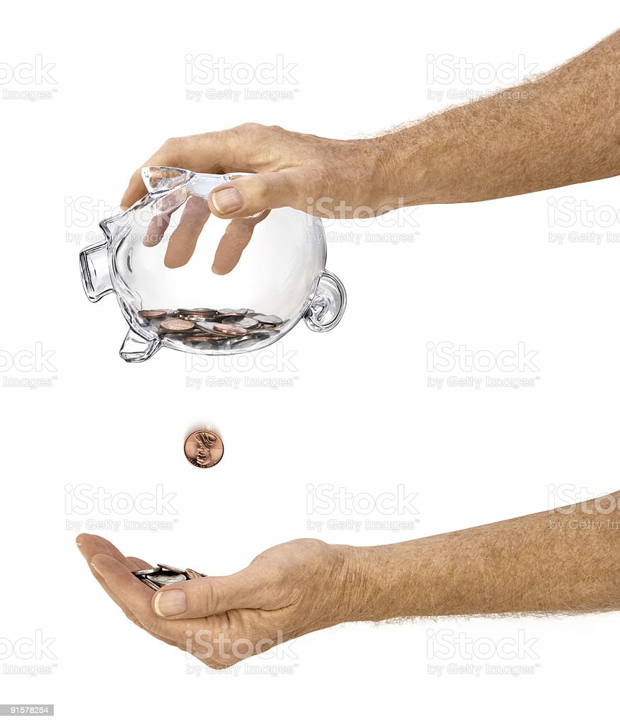 Elderly Male Shaking Coins From Clear Piggy Bank Isolated royalty-free stock photo