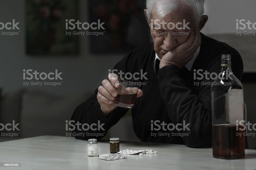 Elderly man addicted stock photo