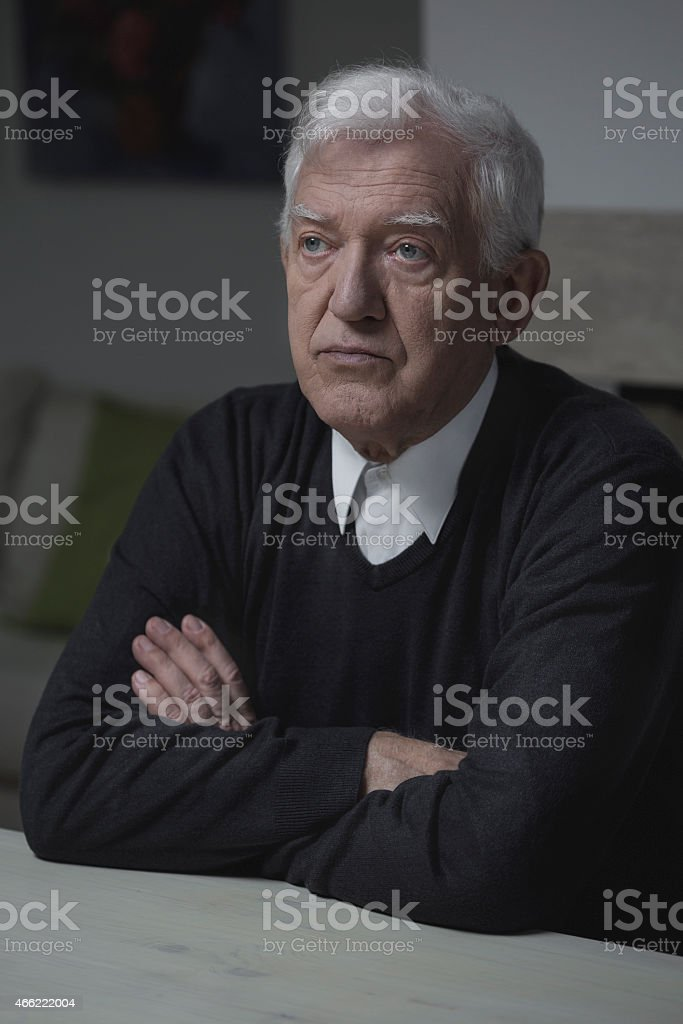 Elderly man alone stock photo