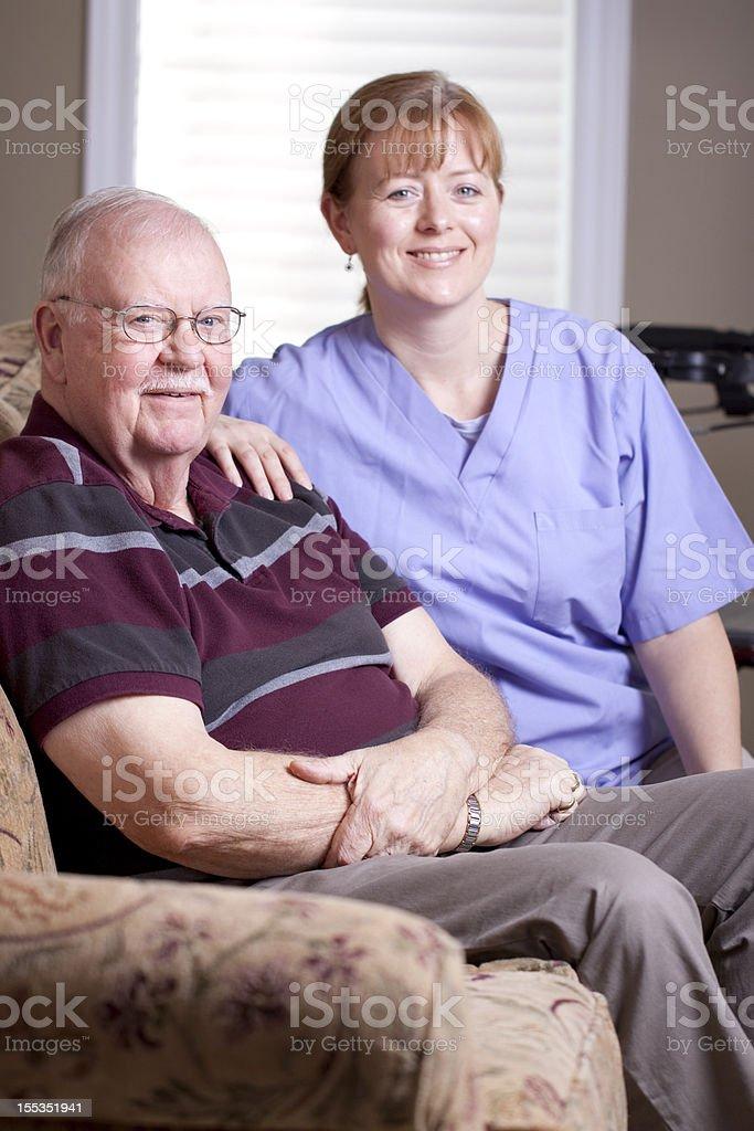 Elderly man and caregiver stock photo