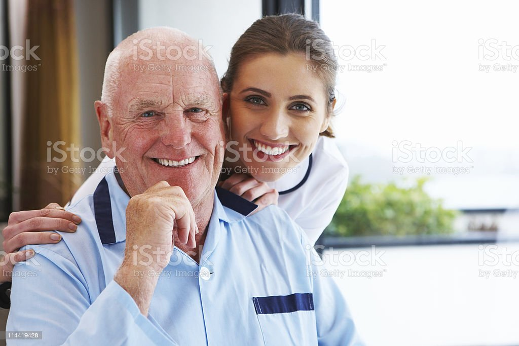 Elderly Man and His Nurse royalty-free stock photo