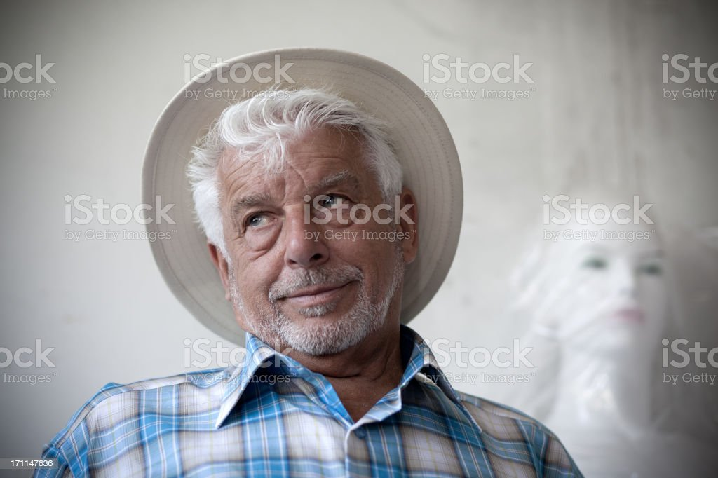 Elderly man and mannequin royalty-free stock photo
