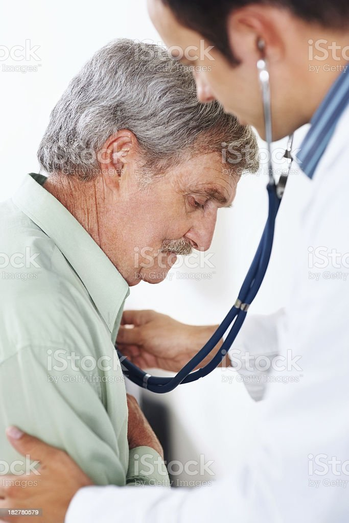 Elderly man being examined with a stethoscope stock photo