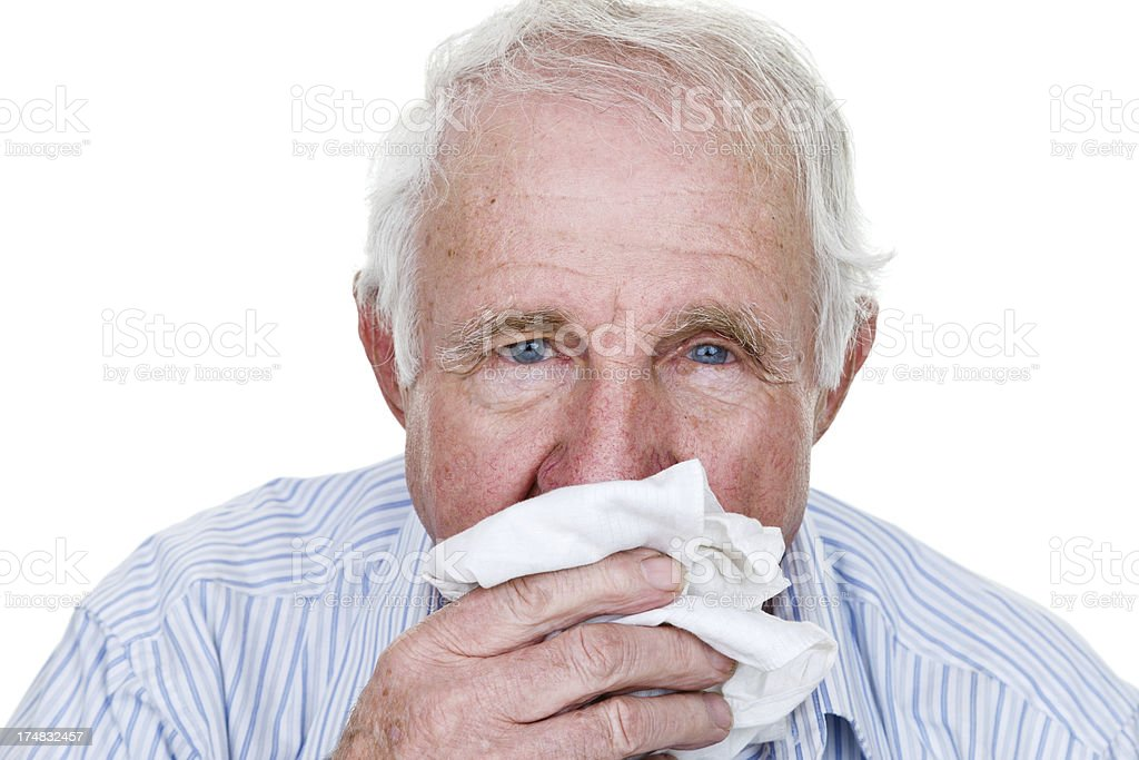 Elderly man blowing his nose royalty-free stock photo