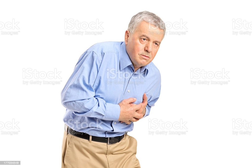 Elderly man clutching his chest to show a heart attack royalty-free stock photo