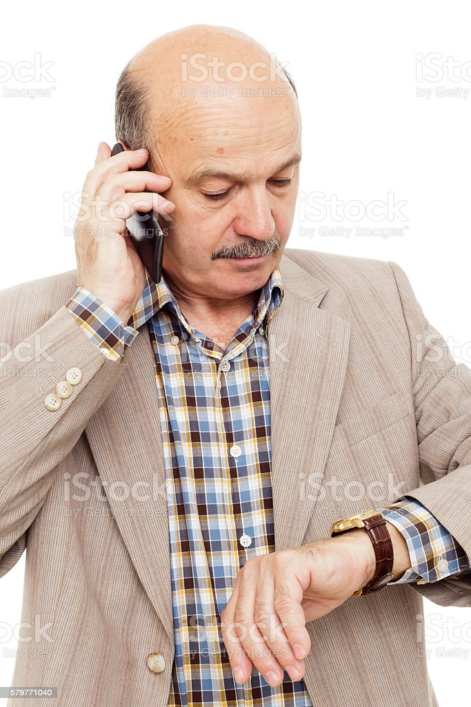 Elderly man complained looking at his watch stock photo