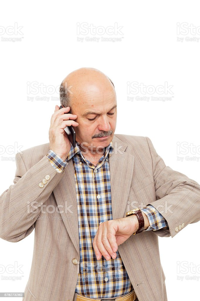Elderly man complained looking at his watch, trying to call stock photo