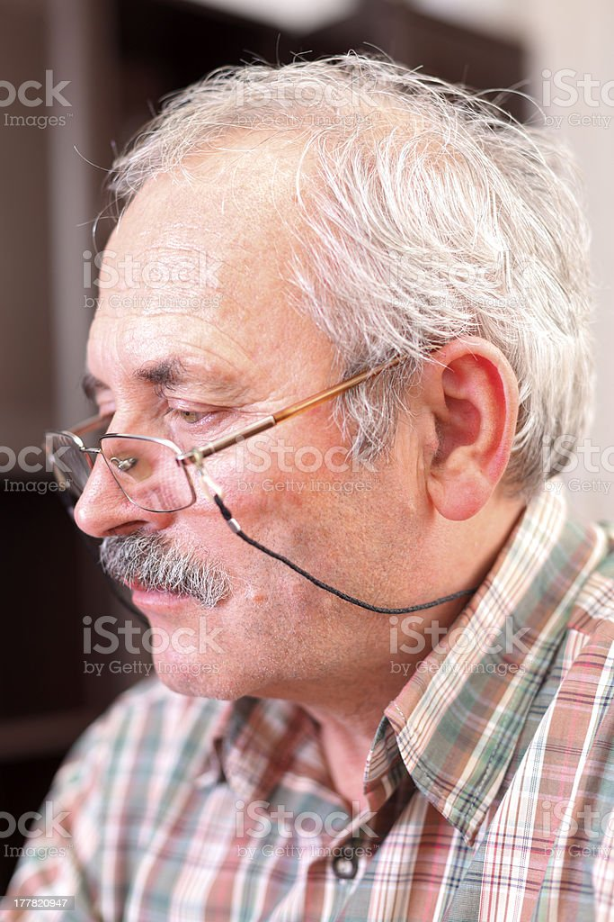 Elderly man concetrating royalty-free stock photo