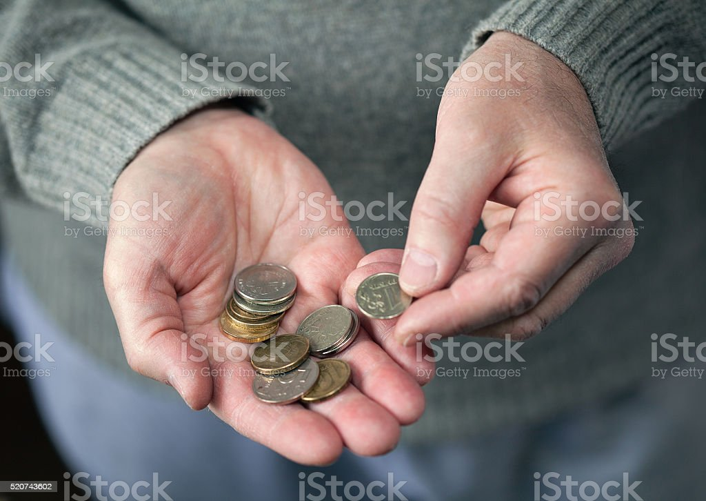 elderly man counting the coins stock photo