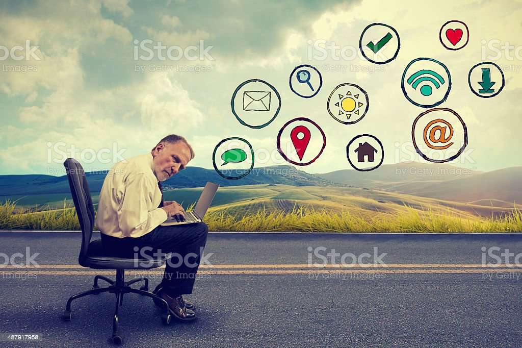 elderly man executive working on computer using social media application stock photo