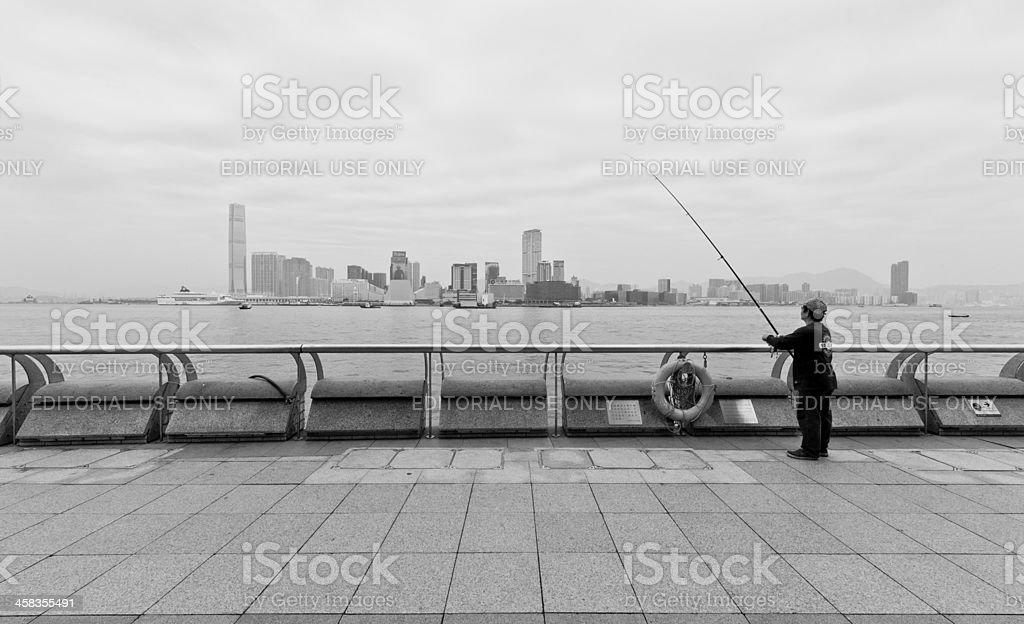Elderly man fishing in Hong Kong royalty-free stock photo