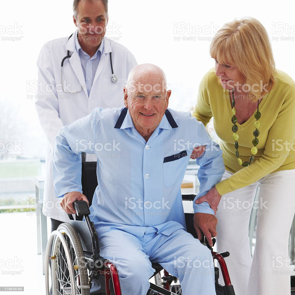 Elderly Man Getting Out of a Wheelchair royalty-free stock photo